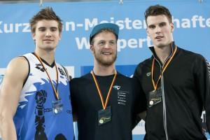 Finale DKM Siegerehrung 100m Schmetterling Männer. *** Marius Kusch; Steffen Deibler; Philipp Wolf